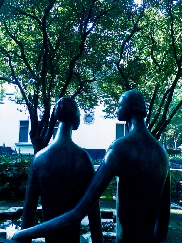 Statue of Man and Woman on a park bench